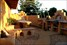 Adobe, mud-brick, mosaic, courtyard, art, creative, water feature, outdoor fireplace, concrete bench-top